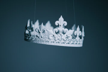 White crown on a blue background on a blogpost about writing royal titles and forms of address.